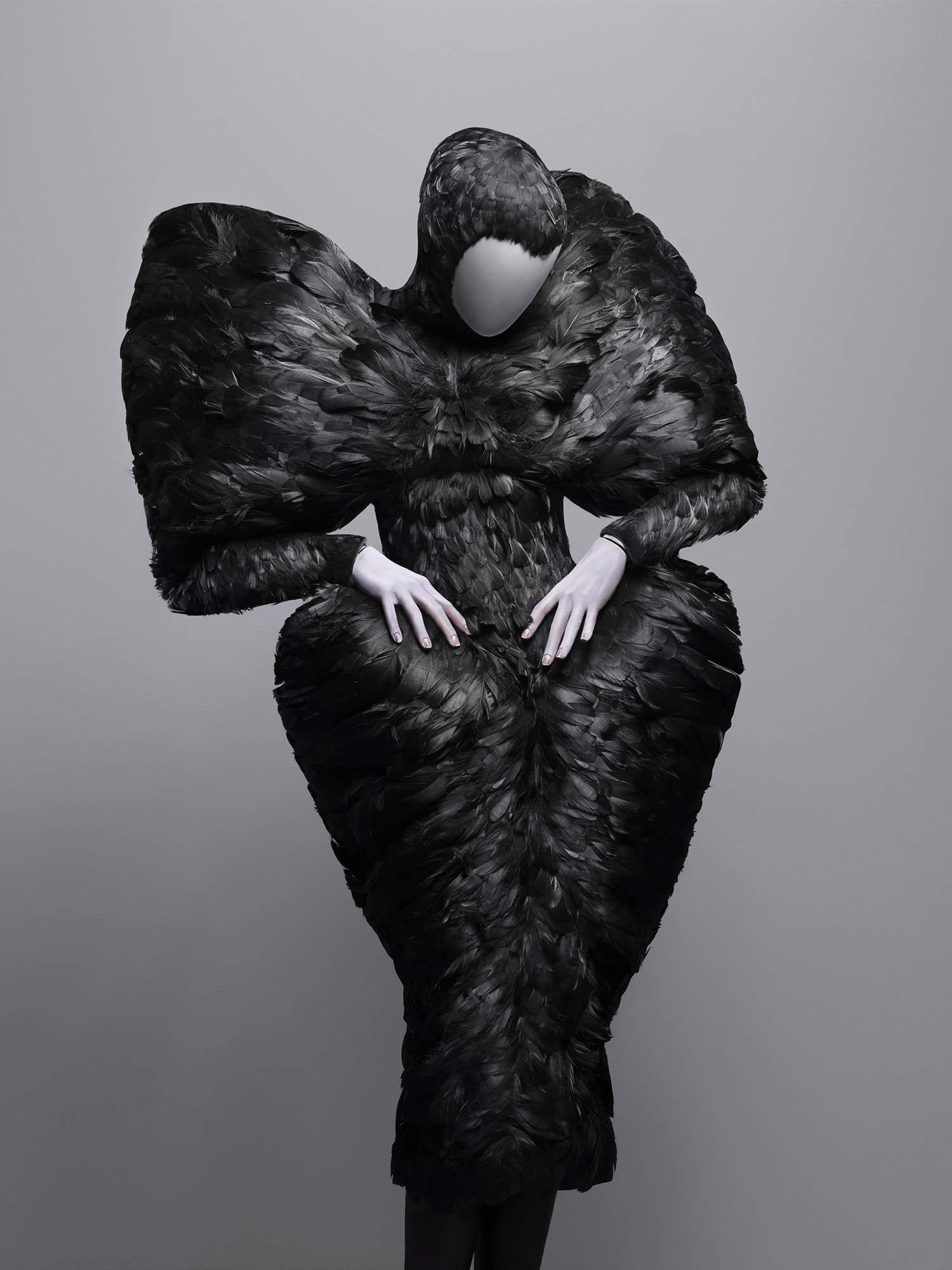 Dramatic black dress made of black duck feathers on mannequin