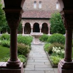 The covered arcades of the Cuxa Cloister surround a garth, or enclosed yard, open to the sky.