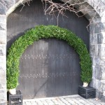 boxwood-covered arches